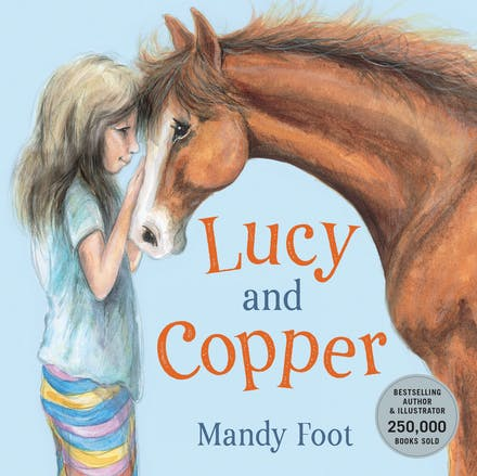 A blue cover with a white girl in striped pants and a turquoise top. She has blonde hair and is petting a brown pony. The title Lucy and Copper is between them about the author's name, Mandy Foot.