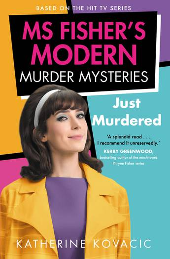 Pink, Yellow, Purple and Turquoise panels are behind a brown haired woman - Geraldine Hakewell - in a purple dress and yellow coat. Above her is a black panel with pink and white text. The text reads: Based on the Hit TV Series. Ms Fisher's Modern Murder Mysteries: Just Murdered by Katherine Kovacic