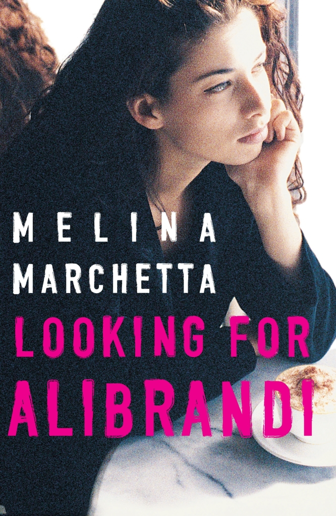 A girl drinking coffee stares out a window. White text below her face reads Melina Marchetta. Pink text below that reads Looking for Alibrandi.